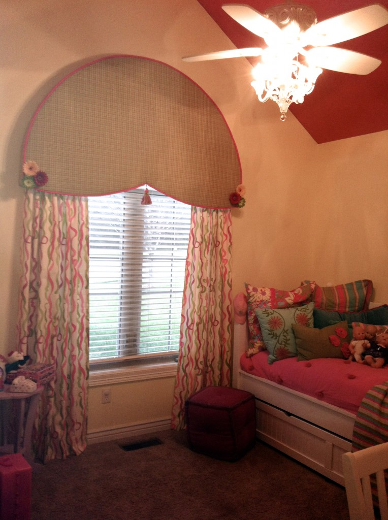 Bright pink metallic ceiling, custom arch window valance and ribbon curtains with chandelier ceiling fan