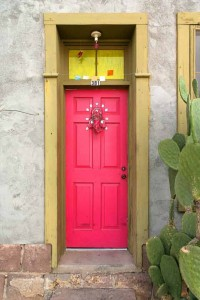 Pink front door uses bright spring color for pop at entry