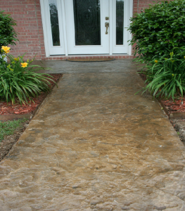 A stamped and stained concrete overlay could be a cost-saving option to replacing your walkway.