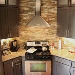 Painted cabinetry and cut stone backsplash
