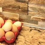 cut stone backsplash and quartz countertop