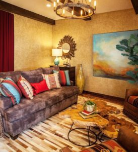 To accommodate large family gatherings, this room features a sleeper sofa and drapery at the room openings for privacy.